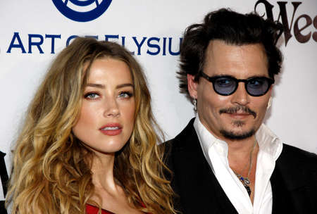 Johnny Depp and Amber Heard at the Art Of Elysium's 9th Annual Heaven Gala held at the 3LABS in Culver City, USA on January 9, 2016.