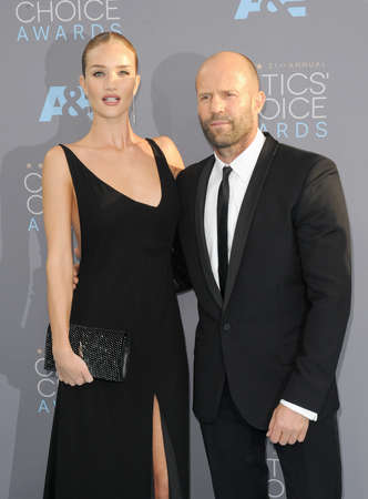 barker: Rosie Huntington-Whiteley and Jason Statham at the 21st Annual Critics Choice Awards held at the Barker Hangar in Santa Monica, USA on January 17, 2016. Editorial