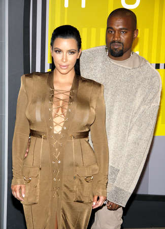 LOS ANGELES, CA - AUGUST 30, 2015: Kanye West and Kim Kardashian at the 2015 MTV Video Music Awards held at the Microsoft Theater in Los Angeles, USA on August 30, 2015. Stock Photo - 51149206