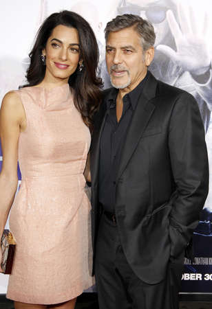 HOLLYWOOD, CA, USA - OCTOBER 26, 2015: Amal Clooney and George Clooney at the Los Angeles premiere of Our Brand Is Crisis held at the TCL Chinese Theatre in Hollywood. Редакционное