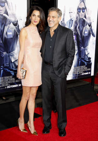 hollywood: HOLLYWOOD, CA, USA - OCTOBER 26, 2015: Amal Clooney and George Clooney at the Los Angeles premiere of Our Brand Is Crisis held at the TCL Chinese Theatre in Hollywood. Editorial