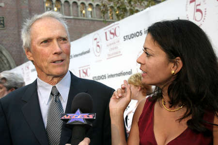 ruiz: LOS ANGELES, CA - SEPTEMBER 26, 2004: Clint Eastwood and Dina Ruiz at the 75th Diamond Jubilee Celebration for the USC School of Cinema-Television held at the USCs Bovard Auditorium in Los Angeles, USA on September 26, 2004. Editorial