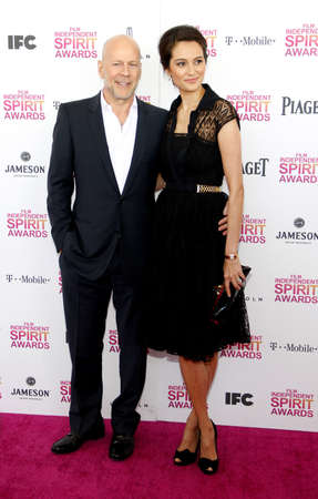 willis: Bruce Willis and Emma Heming at the 2013 Film Independent Spirit Awards held at the Santa Monica Beach in Los Angeles, United States, 230213. Editorial