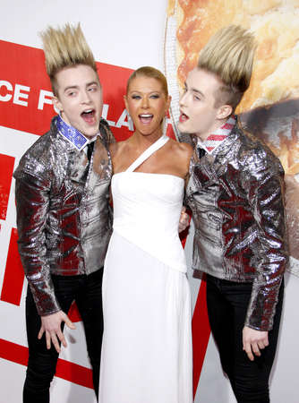 John Grimes, Tara Reid and Edward Grimes at the Los Angeles premiere of American Reunion held at the Graumans Chinese Theater in Hollywood on March 19, 2012. Editorial
