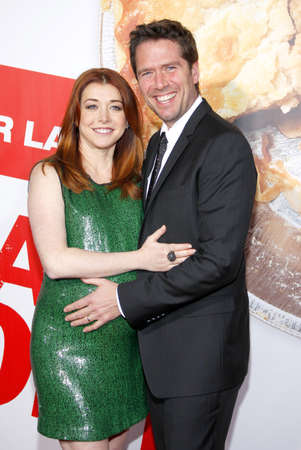 Alyson Hannigan and Alexis Denisof at the Los Angeles premiere of American Reunion held at the Graumans Chinese Theater in Hollywood on March 19, 2012.
