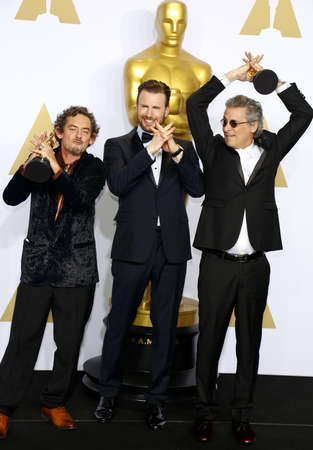 evans: Mark A. Mangini, David White and Chris Evans at the 88th Annual Academy Awards - Press Room held at the Loews Hollywood Hotel in Hollywood, USA on February 28, 2016.