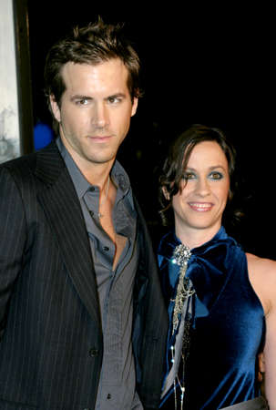 reynolds: HOLLYWOOD, CA - DECEMBER 07, 2004: Ryan Reynolds and Alanis Morissette at the Los Angeles premiere of Blade: Trinity held at the Graumans Chinese Theater in Hollywood, USA on December 7, 2004. Editorial