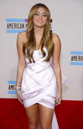 cyrus: Miley Cyrus at the 2010 American Music Awards held at the Nokia Theatre L.A. Live in Los Angeles on November 21, 2010. Credit: Lumeimages.com