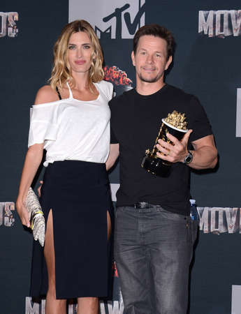 rhea: Mark Wahlberg and Rhea Durham at the 2014 MTV Movie Awards - Press Room held at the Nokia Theatre L.A. Live in Los Angeles, USA on April 13, 2014.