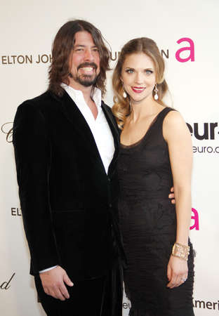 Dave Grohl and Jordyn Groh at the 21st Annual Elton John AIDS Foundation Academy Awards Viewing Party held at the Pacific Design Center in West Hollywood on February 24, 2013 in Los Angeles, California.