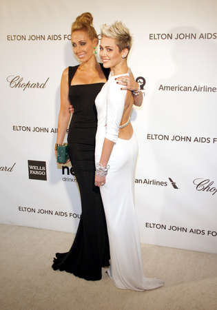 cyrus: Miley Cyrus and Tish Cyrus at the 21st Annual Elton John AIDS Foundation Academy Awards Viewing Party held at the Pacific Design Center in West Hollywood on February 24, 2013 in Los Angeles, California. Credit: Lumeimages.com