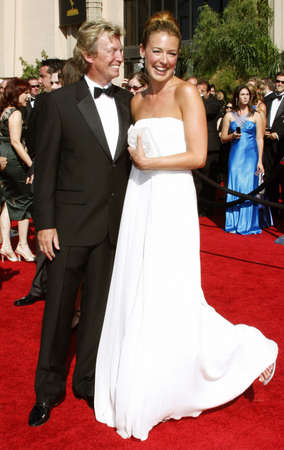attend: Nigel Lythgoe and Cat Deeley attend the 59th Annual Primetime Emmy Awards held at the Shrine Auditorium in Los Angeles, California, United States on September 16, 2007.