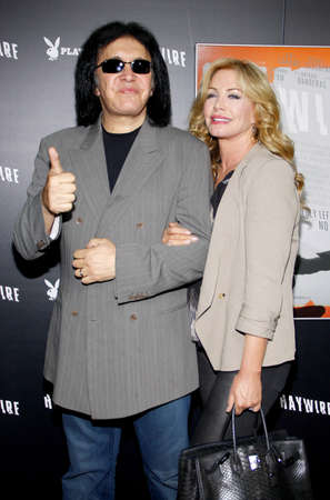 Gene Simmons and Shannon Tweed at the Los Angeles premiere of Haywire held at the DGA Theater in Hollywood on January 5, 2012. Редакционное