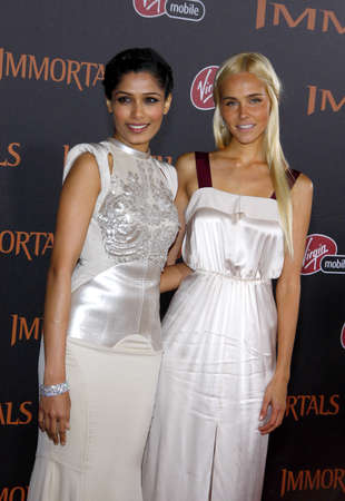 november 3d: Isabel Lucas and Freida Pinto at the Los Angeles premiere of Immortals 3D held at the Nokia Theatre L.A. Live in Los Angeles on November 7, 2011.