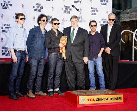 ethan: John Goodman, Oscar Isaac, Ethan and Joel Coen at the John Goodman Handprint and Footprint Ceremony held at the TCL Chinese Theatre in Hollywood, USA on November 14, 2013.