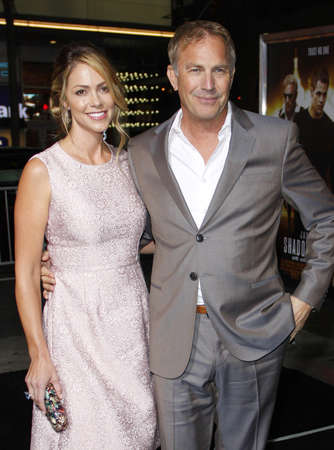christine: Christine Baumgartner and Kevin Costner at the Los Angeles premiere of Jack Ryan: Shadow Recruit held at the TCL Chinese Theatre in Hollywood, USA on January 15, 2014.