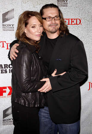 justified: HOLLYWOOD, CA - MARCH 08, 2010: Kurt Sutter and Katey Sagal at the premiere screening of FXs Justified held at the DGA Theater in Hollywood, USA on March 8, 2010.