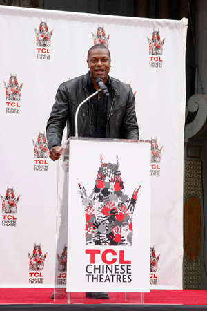 tucker: Chris Tucker at the Jackie Chan Hand and Foot Print Ceremony held at the TCL Chinese Theatre in Hollywood, USA on June 6, 2013.