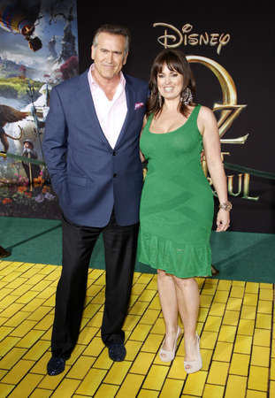 hollywood   california: Bruce Campbell and Ida Gearon at the Oz The Great And Powerful Los Angeles Premiere at the Dolby Theater on April 10, 2013 in Hollywood, California.