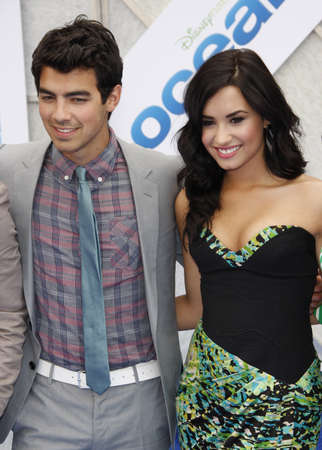Joe Jonas and Demi Lovato at the Los Angeles premiere of 'Oceans' held at the El Capitan Theater in Hollywood, USA on April 17, 2010.