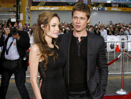 """brad pitt: Angelina Jolie and Brad Pitt at the Los Angeles Premiere of """"Ocean's Thirteen"""" held at the Grauman's Chinese Theatre in Hollywood, USA, on June 5, 2006."""
