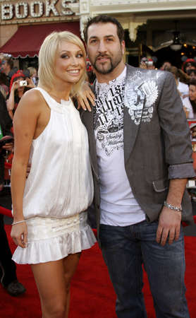 attend: Joey Fatone and Kym Johnson attend the World Premiere of Pirates of the Caribbean: At Worlds End held at Disneyland in Anaheim, California on May 19, 2007.