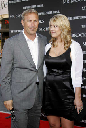 Christine Baumgartner and Kevin Costner at the Los Angeles Premiere of Mr. Brooks held at the Graumans Chinese Theater in Hollywood on May 22, 2007.
