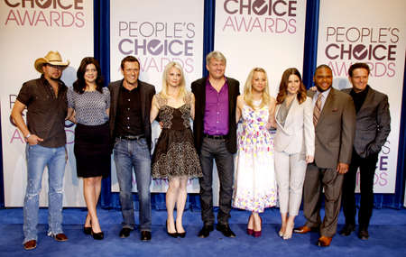 casey: BEVERLY HILLS, CA - NOVEMBER 15, 2012: Jason Aldean, Casey Wilson, Jason O'Mara, Monica Potter, Fred Nelson, Kaley Cuoco, Sophia Bush, Anthony Anderson and Mark Burnett at the People's Choice Awards 2013 Nominations held at the Paley Center in Bev Editorial