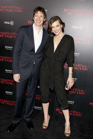 retribution: Milla Jovovich and Paul W.S. Anderson at the Los Angeles premiere of Resident Evil: Retribution held at the Regal Cinemas L.A. Live in Los Angeles, USA on September 12, 2012.