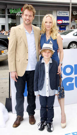 poppers: HOLLYWOOD, CA - JUNE 12, 2011: James Tupper, Homer Laffoon and Anne Heche at the Los Angeles premiere of Mr. Poppers Penguins held at the Graumans Chinese Theatre in Hollywood, USA on June 12, 2011. Editorial