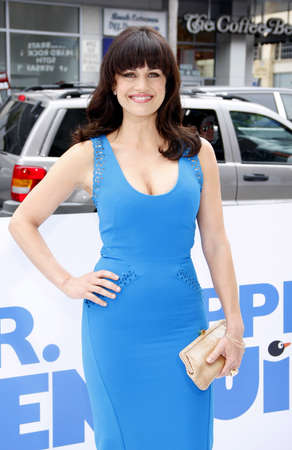 poppers: HOLLYWOOD, CA - JUNE 12, 2011: Carla Gugino at the Los Angeles premiere of Mr. Poppers Penguins held at the Graumans Chinese Theatre in Hollywood, USA on June 12, 2011.