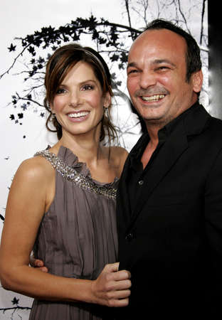premonition: Sandra Bullock and Mennan Yapo at the Los Angeles Premiere of Premonition held at the Cinerama Dome in Hollywood, USA on March 12, 2007. Editorial