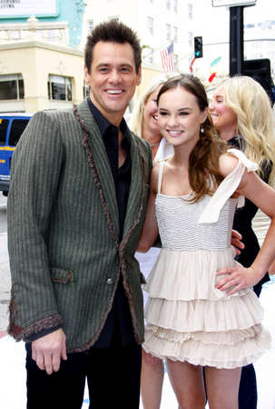 poppers: HOLLYWOOD, CA - JUNE 12, 2011: Jim Carrey and Madeline Carroll at the Los Angeles premiere of Mr. Poppers Penguins held at the Graumans Chinese Theatre in Hollywood, USA on June 12, 2011.
