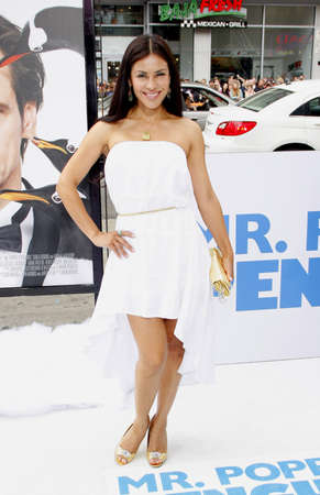 poppers: HOLLYWOOD, CA - JUNE 12, 2011: Carla Ortiz at the Los Angeles premiere of Mr. Poppers Penguins held at the Graumans Chinese Theatre in Hollywood, USA on June 12, 2011. Editorial
