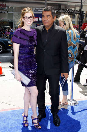 hathaway: HOLLYWOOD, CA - APRIL 10, 2011: Anne Hathaway and George Lopez at the Los Angeles premiere of 'Rio' held at the Grauman's Chinese Theater in Hollywood, USA on April 10, 2011. Editorial