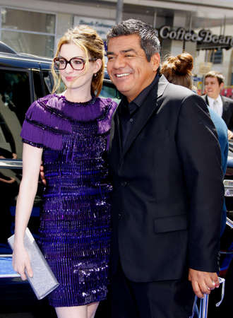 hathaway: HOLLYWOOD, CA - APRIL 10, 2011: Anne Hathaway and George Lopez at the Los Angeles premiere of Rio held at the Graumans Chinese Theater in Hollywood, USA on April 10, 2011.