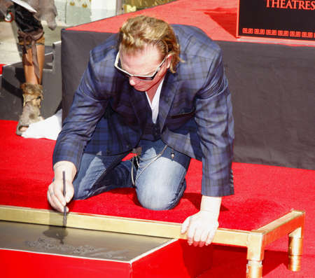 october 31: HOLLYWOOD, CA - OCTOBER 31, 2011: Mickey Rourke Hand And Footprint Ceremony held at Graumans Chinese Theater in Hollywood, USA on October 31, 2011.