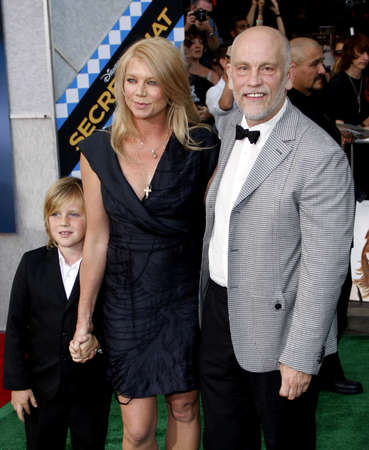 secretariat: HOLLYWOOD, CA - SEPTEMBER 30, 2010: John Malkovich and Peta Wilson at the Los Angeles premiere of Secretariat held at the El Capitan Theater in Hollywood, USA on September 30, 2010.
