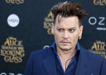 Johnny Depp at the Los Angeles premiere of 'Alice Through The Looking Glass' held at the El Capitan Theater in Hollywood, USA on May 23, 2016. Stock Photo - 57139072