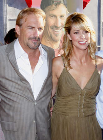 Kevin Costner and Christine Baumgartner at the Los Angeles premiere of Swing Vote held at the El Capitan Theater in Hollywood on July 24, 2008. Editorial