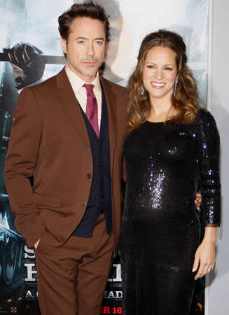 Robert Downey Jr and Susan Downey at the Los Angeles premiere of Sherlock Holmes: A Game Of Shadows held at the Regency Village Theater in Westwood on November 6, 2011. Редакционное