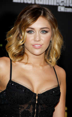 cyrus: Miley Cyrus at the Los Angeles premiere of The Hunger Games held at the Nokia Theatre L.A. Live in Los Angeles on March 12, 2012. Editorial