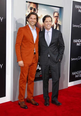 cooper: Bradley Cooper and Ed Helms at the Los Angeles premiere of The Hangover Part III held at the Mann Village Theater in Los Angeles, United States, 200513. Editorial