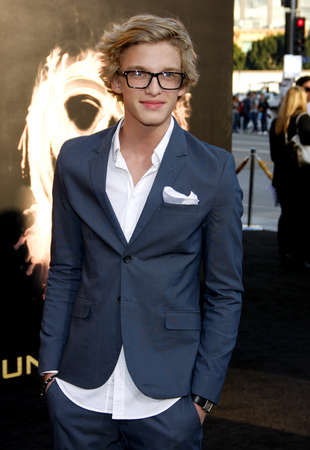 cody: Cody Simpson at the Los Angeles premiere of The Hunger Games held at the Nokia Theatre L.A. Live in Los Angeles on March 12, 2012.