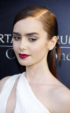 mortal: Lily Collins at the Los Angeles premiere of The Mortal Instruments: City Of Bones held at the Cinerama Dome in Hollywood, USA on August 12, 2013.