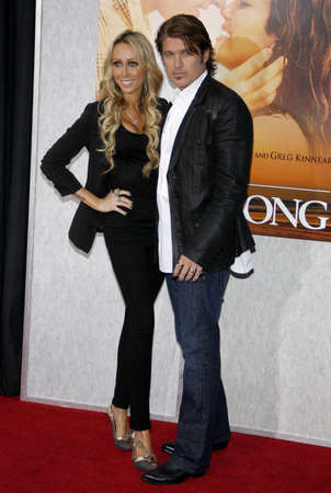 cyrus: Billy Ray Cyrus and Tish Cyrus at the Los Angeles premiere of 'The Last Song' held at the ArLight Cinemas in Hollywood, USA on March 25, 2010. Editorial