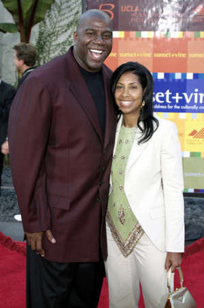 bourne: HOLLYWOOD, CA - JULY 15, 2004: Magic Johnson and Cookie Johnson at the World premiere of The Bourne Supremacy held at the ArcLight Cinema in Hollywood, USA on July 15, 2004.