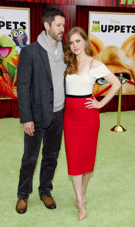darren: HOLLYWOOD, CA - NOVEMBER 12, 2011. Darren Le Gallo and Amy Adams at the World premiere of 'The Muppets' held at El Capitan Theater in Hollywood, USA on November 12, 2011.