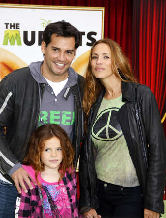 cristian: HOLLYWOOD, CA  - NOVEMBER 12, 2011. Cristian de la Fuente and Angelica Castro at the World premiere of The Muppets held at El Capitan Theater in Hollywood, USA on November 12, 2011. Editorial