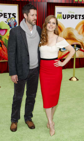HOLLYWOOD, CA - NOVEMBER 12, 2011. Darren Le Gallo and Amy Adams at the World premiere of The Muppets held at El Capitan Theater in Hollywood, USA on November 12, 2011.